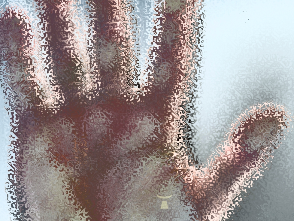 image of a hand placed on the opaque and dented pane of a bathroom